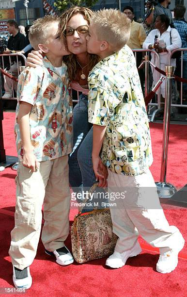 Actors Dylan and Cole Sprouse kiss their mother Melodie on Mother's Day at the charity premiere of 'Star Wars Episode II Attack of the Clones' May12...