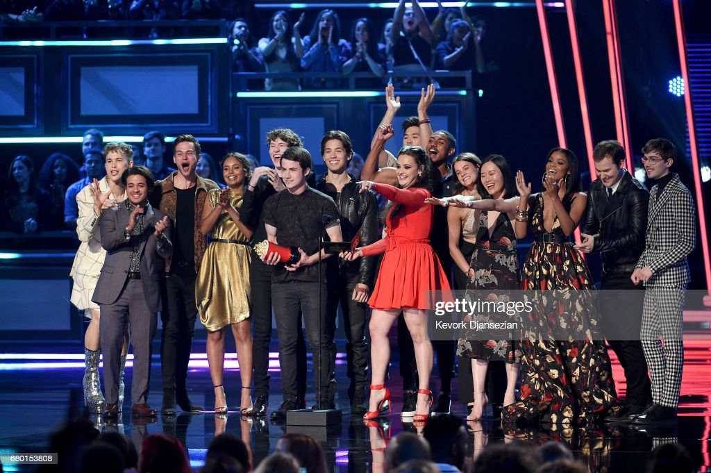 Actors Dylan Minnette and Katherine Langford (C) with the cast of '13 Reasons Why' speak onstage during the 2017 MTV Movie And TV Awards at The Shrine Auditorium on May 7, 2017 in Los Angeles, California.