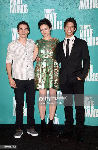 Actors Dylan O'Brien Crystal Reed and Tyler Posey pose in the press room during the 2012 MTV Movie Awards held at Gibson Amphitheatre on June 3 2012...