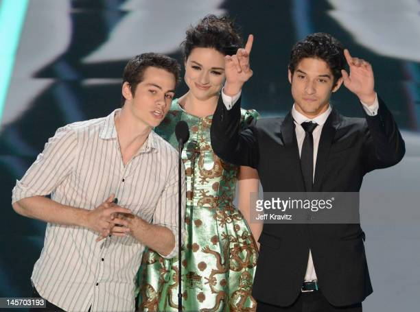 Actors Dylan O'Brien Crystal Reed and Tyler Posey speak onstage at the 2012 MTV Movie Awards at Gibson Amphitheatre on June 3 2012 in Universal City...