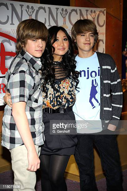 Actors Dylan Sprouse Brenda Song and Cole Sprouse visit The World of Disney store on March 6 2009 in New York City