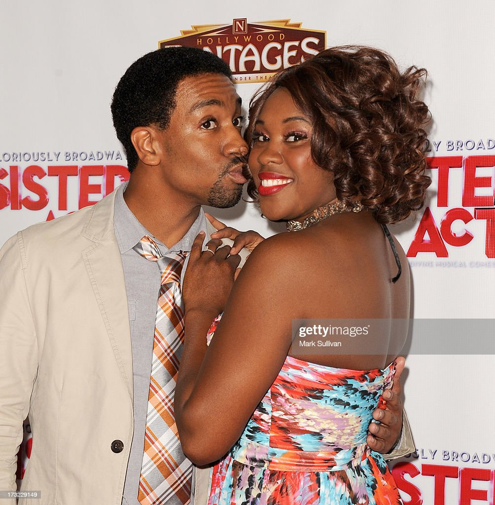 Actors E. Clayton Cornelious (L) and Ta'rea Campbell attend the premiere of 'Sister Act' at the Pantages Theatre on July 9, 2013 in Hollywood, California.