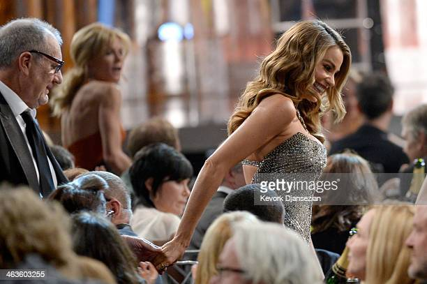 Actors Ed O'Neill and Sofia Vergara walk onstage during the 20th Annual Screen Actors Guild Awards at The Shrine Auditorium on January 18 2014 in Los...