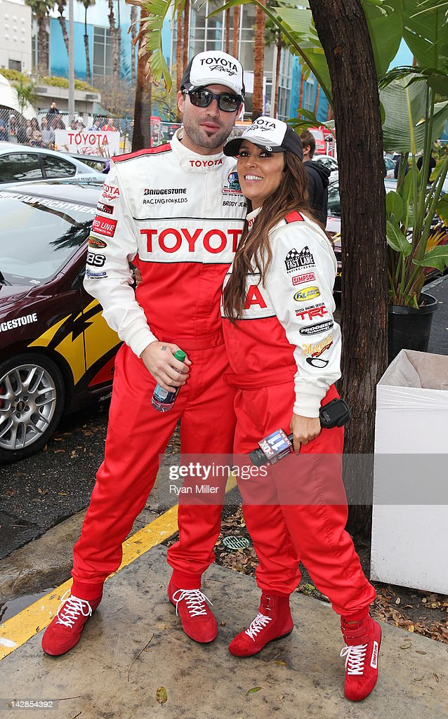 Actors Eddie Cibrian (L) and Jillian Barberie Reynolds (R) pose during the 36th Annual Toyota Pro/Celebrity Race - Press Practice Day of the Toyota Grand Prix of Long Beach on April 13, 2012 in Long Beach, California.