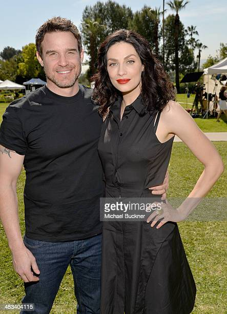 Actors Eddie McClintock and Joanne Kelly attend NBCUniversal's Summer Press Day at Langham Hotel on April 8 2014 in Pasadena California