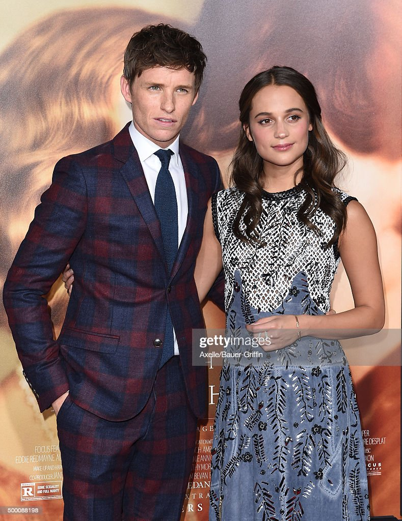 Actors Eddie Redmayne and Alicia Vikander arrive at the premiere of Focus Features' 'The Danish Girl' at Westwood Village Theatre on November 21, 2015 in Westwood, California.