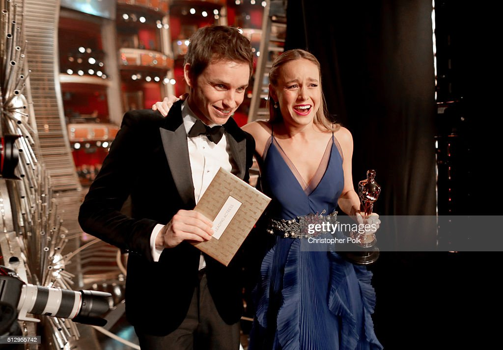 Actors Eddie Redmayne (L) and Brie Larsen walk offstage during the 88th Annual Academy Awards at Dolby Theatre on February 28, 2016 in Hollywood, California.