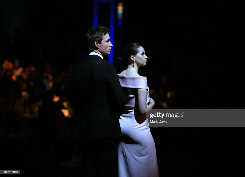 Actors Eddie Redmayne (L) and Felicity Jones onstage at TNT's 21st Annual Screen Actors Guild Awards at The Shrine Auditorium on January 25, 2015 in Los Angeles, California. 25184_021
