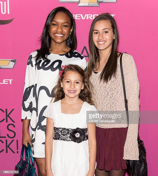Actors Eden Duncan Smith Amanda Troya and Nicolette Pierini from the cast of Annie attend Black Girls Rock 2013 at New Jersey Performing Arts Center...