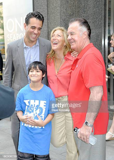 Actors Edie Falco Bobby Cannavale and Tony Sirico pose with a member of the 52nd Street Project at the annual charity day hosted by Cantor Fitzgerald...