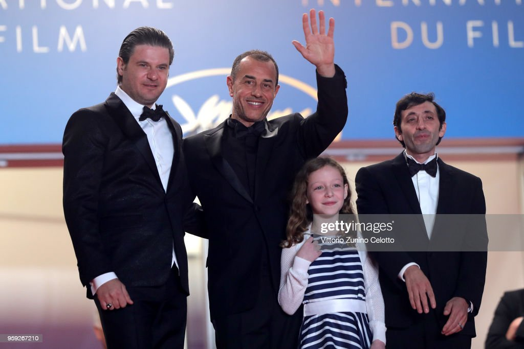 Actors Edoardo Pesce, director Matteo Garrone and actors Alida Baldari Calabria and Marcello Fonte attend the screening of 'Dogman' during the 71st annual Cannes Film Festival at Palais des Festivals on May 16, 2018 in Cannes, France.