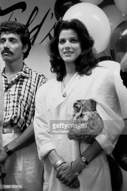 Actors Edward James Olmos and Saundra Santiago promote their television show 'Miami Vice' during a visit to a department store in Chicago Illinois...