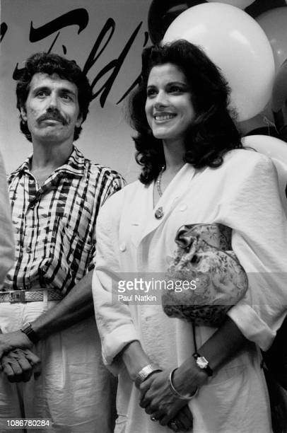 Actors Edward James Olmos and Saundra Santiago promote their television show 'Miami Vice' during a visit to a department store in Chicago, Illinois,...