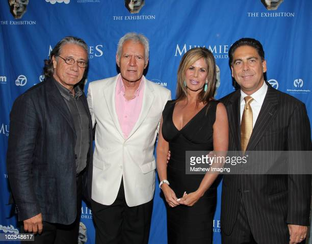 Actors Edward James Olmos TV personality Alex Trebek guest and Marc Corwin CEO of American Exhibitions Inc arrive at the Mummies of the World Exhibit...