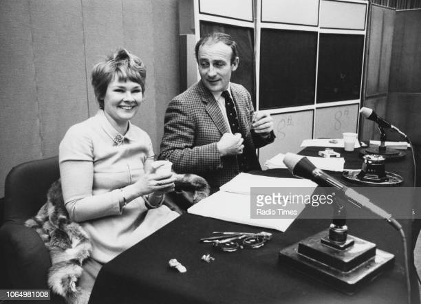 Actors Edward Woodward and Judi Dench reading scripts in front of microphones, November 23rd 1970.