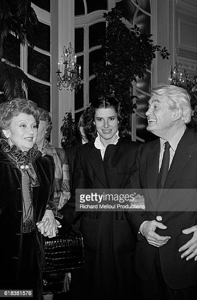 Actors Edwige Feuillere Fanny Ardant and Jean Marais attend an event in Paris where Feuillere was decorated with the Legion d'Honneur medal Edwige is...