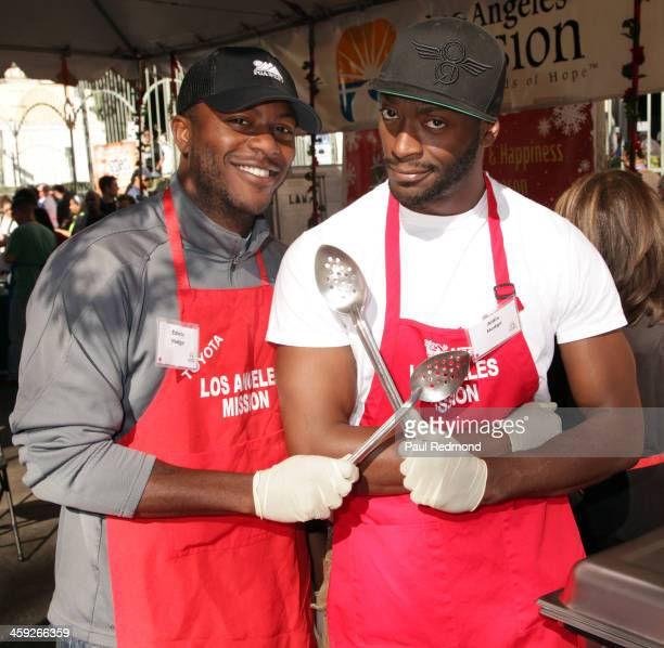 Actors Edwin Hodge and Aldis Hodge attend the Los Angeles Mission Christmas Celebration on Skid Row at Los Angeles Mission on December 24 2013 in Los...