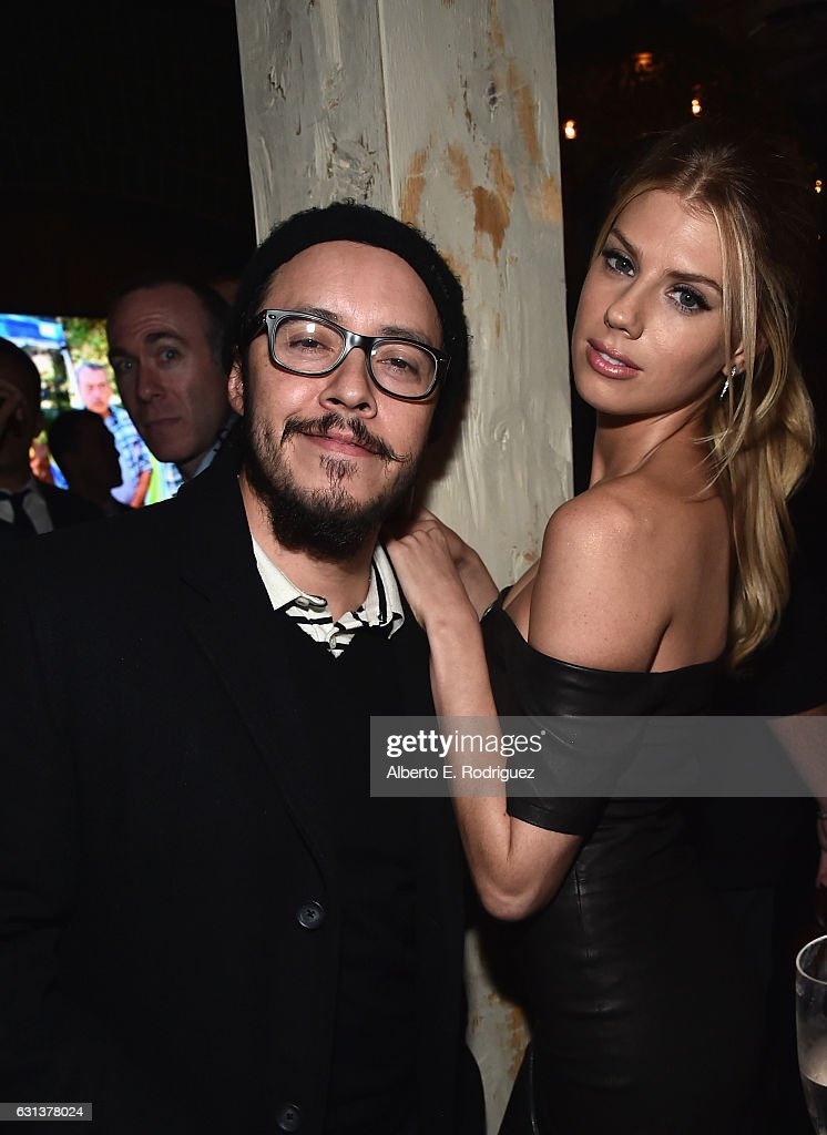 Actors Efren Ramirez and Charlotte McKinney attend the premiere party for Crackle's 'Mad Families' at Catch on January 9, 2017 in West Hollywood, California.