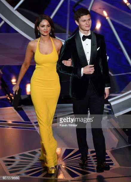 Actors Eiza Gonzalez and Ansel Elgort walk onstage during the 90th Annual Academy Awards at the Dolby Theatre at Hollywood Highland Center on March 4...