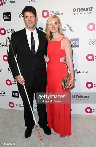 Actors EJ Scott and Deborah Ann Woll attend the 23rd Annual Elton John AIDS Foundation's Oscar Viewing Party on February 22 2015 in West Hollywood...