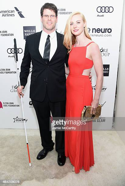 Actors EJ Scott and Deborah Ann Woll attend the 23rd Annual Elton John AIDS Foundation Academy Awards Viewing Party on February 22 2015 in Los...