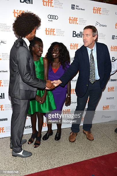 Actors Eka Darville Healesville Joel Xzannjah Matsi and Hugh Laurie at the Mr Pip premiere during the 2012 Toronto International Film Festival at...