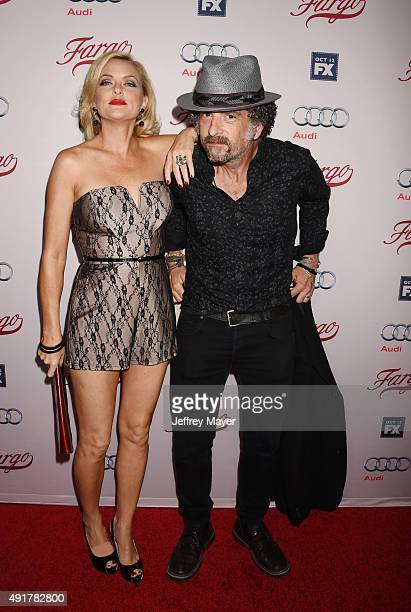 Actors Elaine Hendrix and John Ales attend the premiere of FX's 'Fargo' Season 2 held at ArcLight Cinemas on October 7, 2015 in Hollywood, California.