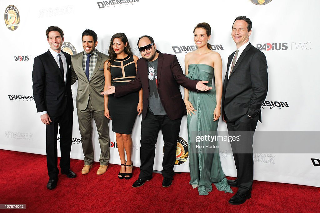 Actors Eli Roth, Lorenza Izzo, director Nicolas Lopez, actress Andrea Osvart and the films producers attend the premiere of 'Aftershock' at Mann Chinese 6 on May 1, 2013 in Los Angeles, California.
