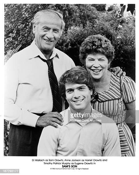 """Actors Eli Wallach,Timothy Patrick Murphy and actress Anne Jackson pose on set for the movie""""Sam's Son"""" in 1984."""