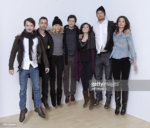 Actors Elijah Wood, Jeremy Strong, Malin Akerman, Adam Brody, Rebecca Hall, Josh Duhamel and Katie Holmes pose for a portrait during the 2010...