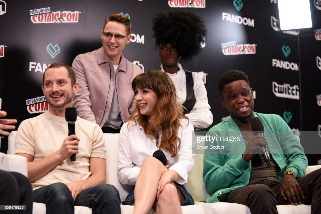 Actors Elijah Wood, Sam Barnett, Hannah Marks, Jade Eshete and Mpho Koaho speak onstage at the New York Comic Con Live Stage in partnership with FANDOM and Twitch on October 6, 2017 in New York City.