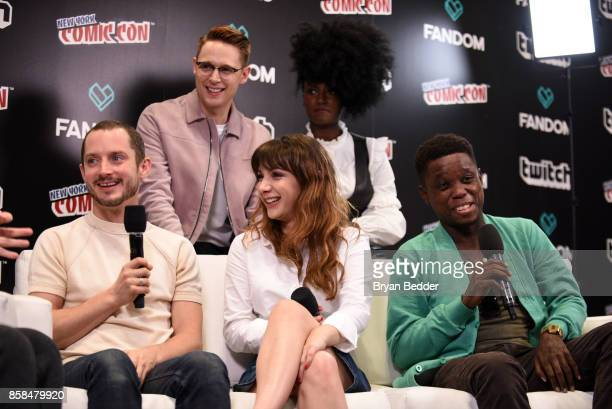 Actors Elijah Wood Sam Barnett Hannah Marks Jade Eshete and Mpho Koaho speak onstage at the New York Comic Con Live Stage in partnership with FANDOM...