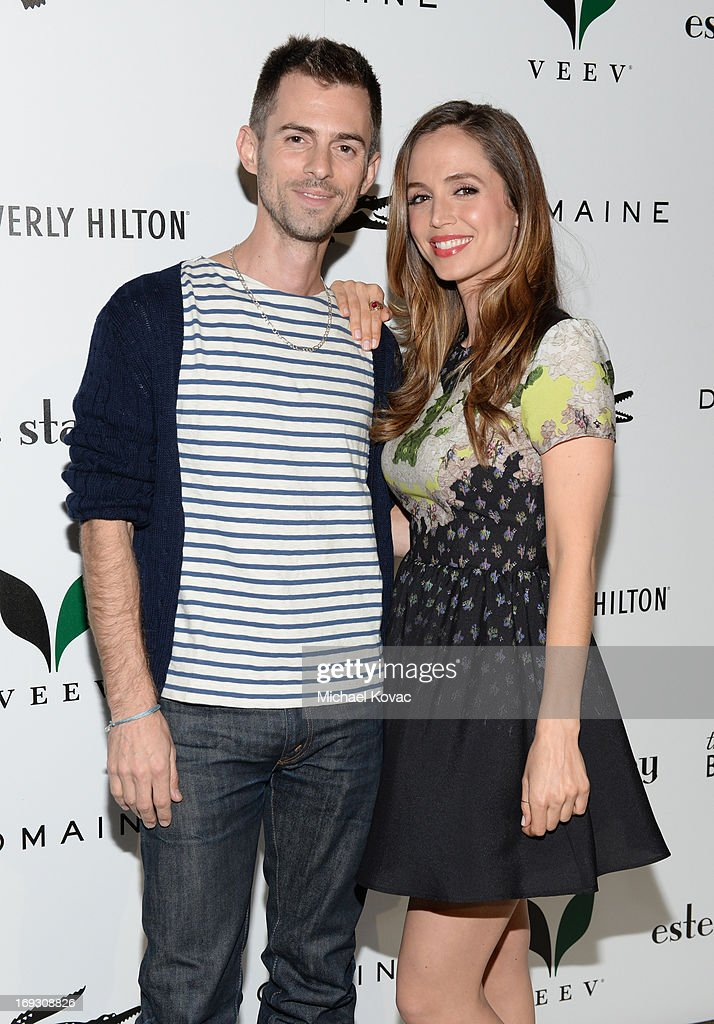 Actors Eliza Dushku (R) and brother Nate Dushku attend The Beverly Hilton unveiling of the redesigned Aqua Star Pool By Estee Stanley at The Beverly Hilton Hotel on May 22, 2013 in Beverly Hills, California.