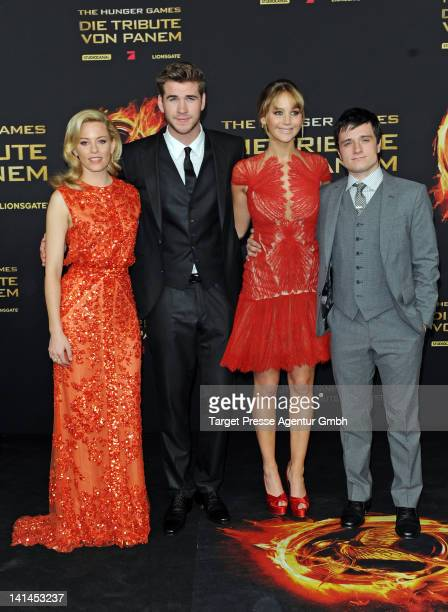 Actors Elizabeth Banks, Liam Hemsworth, Jennifer Lawrence and Josh Hutcherson attend the Germany premiere of 'The Hunger Games' at Cinestar on March...