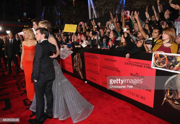 Actors Elizabeth Banks Liam Hemsworth Jennifer Lawrence and Josh Hutcherson attend premiere of Lionsgate's The Hunger Games Catching Fire Red Carpet...