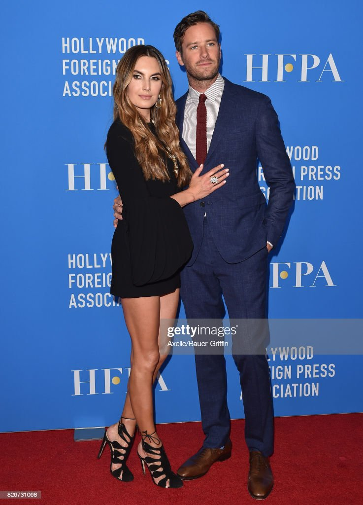 Actors Elizabeth Chambers and Armie Hammer arrive at the Hollywood Foreign Press Association's Grants Banquet at the Beverly Wilshire Four Seasons Hotel on August 2, 2017 in Beverly Hills, California.
