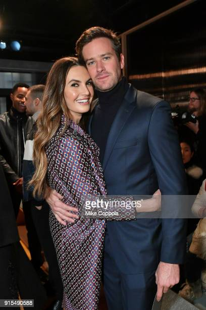 Actors Elizabeth Chambers and husband Armie Hammer pose for a photo at BOSS Menswear Front Row at New York Fashion Week Mens' on February 7 2018 in...