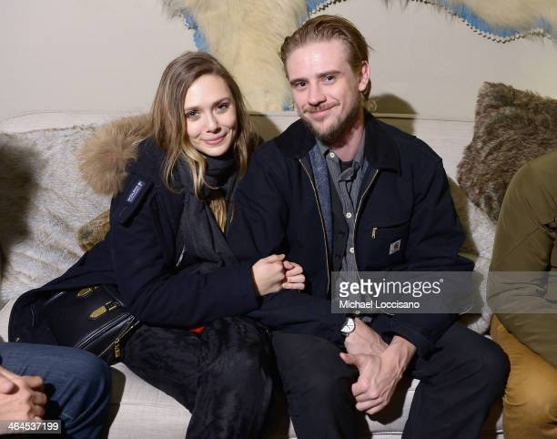 Actors Elizabeth Olsen and Boyd Holbrook attend The Snow Lodge x Eveleigh Little Accidents party on January 22 2014 in Park City Utah