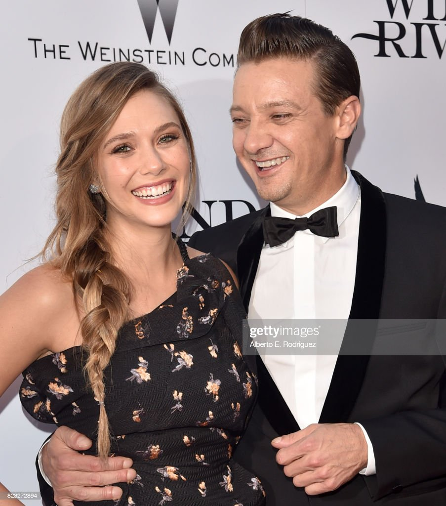 Actors Elizabeth Olsen and Jeremy Renner attend the premiere of The Weinstein Company's 'Wind River' at The Theatre at Ace Hotel on July 26, 2017 in Los Angeles, California.