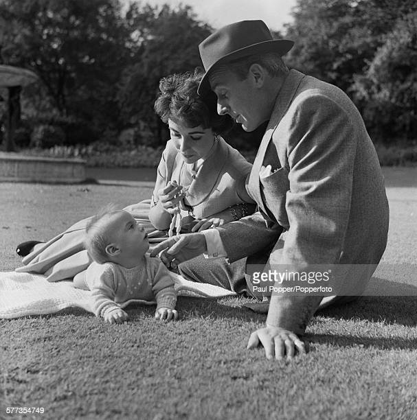 Actors Elizabeth Taylor and her husband Michael Wilding with their baby son Michael Howard Wilding in Hyde Park London October 1953