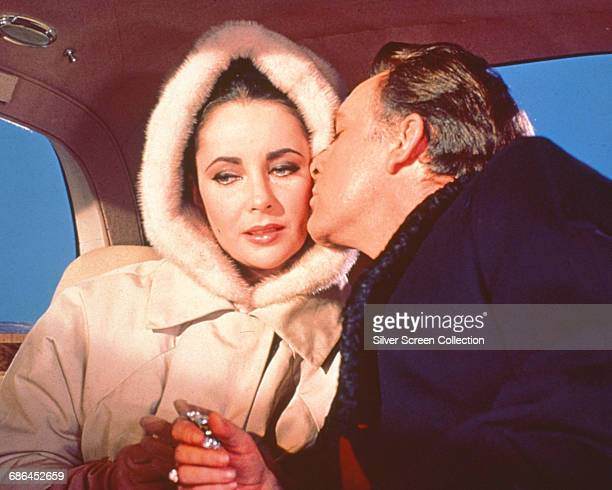 Actors Elizabeth Taylor as Frances Andros and Richard Burton as Paul Andros in the film 'The V.I.P.s', 1963.