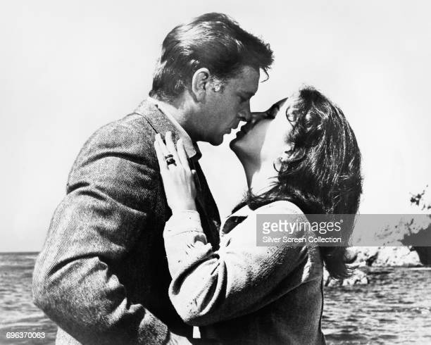 Actors Elizabeth Taylor as Laura Reynolds and Richard Burton as Dr Edward Hewitt in the film 'The Sandpiper' 1965