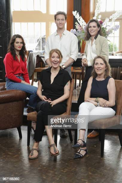 Actors Ella Rumpf Alexander Fehling Nora Tschirner and seated director Vanessa Jopp with Petra Mueller pose during 'Gut gegen Nordwind' on set...