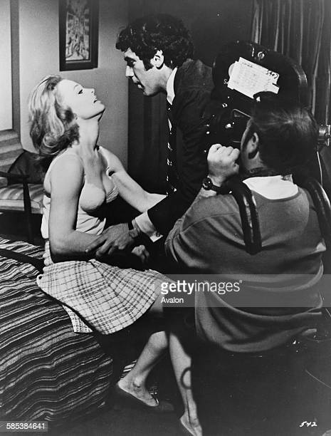 Actors Elliott Gould and Angel Tompkins filming a bedroom scene for 'I Love My Wife' with cameraman Vilis Lapenieks December 31st 1970