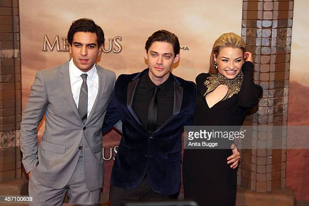 Actors Elyas M'Barek Tom Payne and Emma Rigby attend the The Physician German premiere at Zoo Palast on December 16 2013 in Berlin Germany