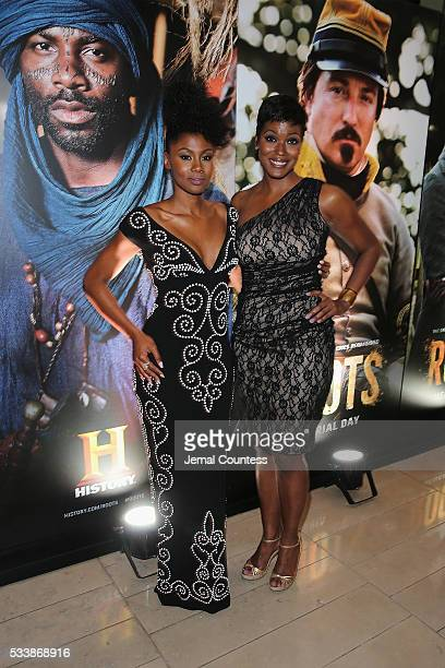 Actors Emayatzy Corinealdi and Cassandra Freeman attend the premiere screening of Night One of the four night epic event series Roots hosted by...