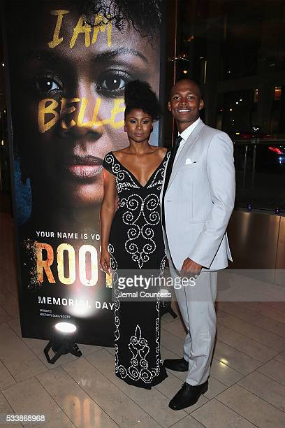 Actors Emayatzy Corinealdi and Sedale Threatt Jr attend the premiere screening of Night One of the four night epic event series Roots hosted by...