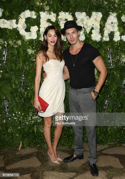 Actors Emi Renata and Lewis Tan attend the Maison StGermain LA debut on August 2 2017 in Los Angeles California