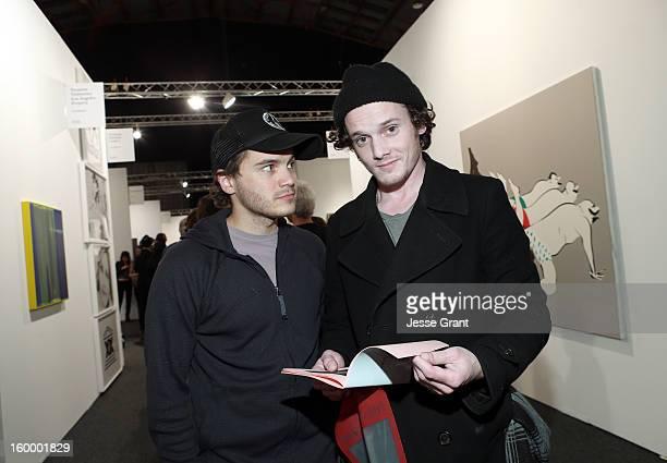 Actors Emile Hirsch and Anton Yelchin attend Art Los Angeles Contemporary opening night at Barker Hangar on January 24 2013 in Santa Monica California