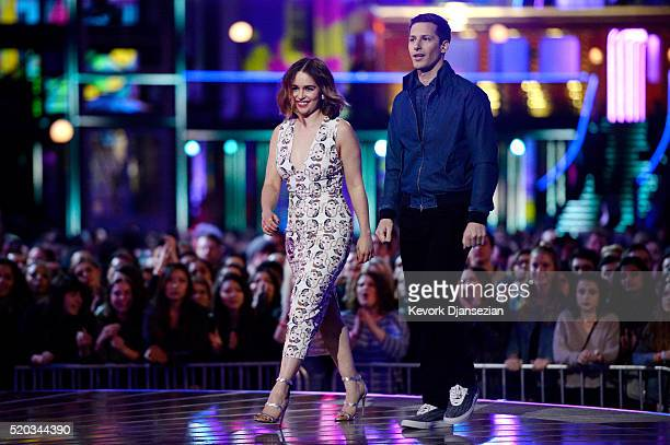 Actors Emilia Clarke and Andy Samberg walk onstage during the 2016 MTV Movie Awards at Warner Bros Studios on April 9 2016 in Burbank California MTV...